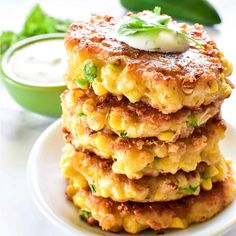 These Sweet Corn Fritters Are Crisp And Golden On The Outside, And Warm And Soft On The Inside. They Taste Like Delicious Balls Of Cornbread Heaven! . Veggie Side Dishes, Side Dishes Easy, Vegetable Dishes, Corn Fritter Recipes, Corn Recipes, Dinner Recipes, Sweet Corn Fritters, Cilantro Lime Sauce