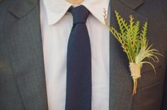 green bout - navy tie - gray suit--- I don't like the green thing but the grey and navy would go perfect with the wedding
