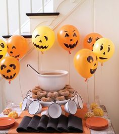 Draw jack-o-lantern faces on yellow and orange balloons for easy Halloween party decorating that's not-so-spooky.