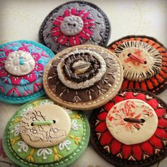 Embroidered brooches out of felt, buttons and beads by Crochetka at fler.cz