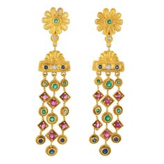 Pair of Gold, Gem-Set and Diamond Fringe Earrings, Ilias Lalaounis   18 kt., topped by two gold flowers centering 2 round emeralds, joined by 2 small round diamonds within concave discs, supporting two fan-shaped and rectangular panels centering 2 small round diamonds flanked by 2 round sapphires, suspending a three strand fringe alternating in circular and rectangular-shaped plaques centering 24 round emeralds and rubies, terminating in 6 round sapphires, signed Greece