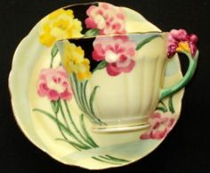 CROWN STAFFORDSHIRE ENGLAND ART DECO FLOWER HANDLE TEA CUP AND SAUCER