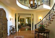 Beautiful front doors and entryway with cascading circular staircase.