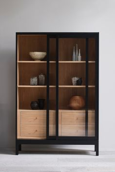 Our Joyce cabinet, shown here in a rather grown up black lacquer, but as we hold our stock in the raw, these can be finished in a range of stock colours, or in our customer's custom paint refs. She's a perfect kitchen workhorse, or on point for display of special objects that need a sliding glass door to protect small fingers. Also possible to store AV inside due to integrated cable access. Many of the ceramics and vessels loaned kindly from Flow Gallery. Metal Furniture, Furniture Design, Cabinet Furniture, Vitrine Design, Console Table Styling, Estilo Interior, Interior Decorating, Interior Design, Shelving