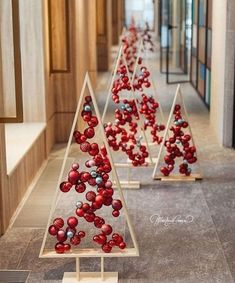 18 Christmas Trees For Small Spaces (Christmas Tree Alternatives) - Mama and More - - Christmas trees are beautiful and festive, but they take up a lot of space. Check out these alternative Christmas trees for small spaces! Decoration Christmas, Wooden Christmas Trees, Noel Christmas, Rustic Christmas, Simple Christmas, Christmas Tree Decorations, Elegant Christmas, Pallet Christmas, Pink Christmas