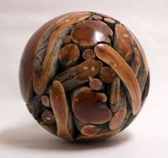 Glue branches together, and cut and sand it into a ball.