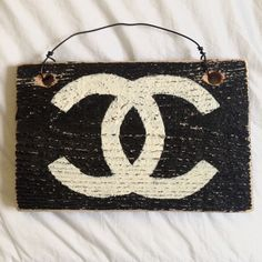 Brandy Melville Chanel Wooden Sign Brandy Melville wooden sign, with the Chanel design. Purchased from the BM store in SoHo, NYC. Height: 5.5 inches, Width: 5.5 inches .No trades!! Brandy Melville Accessories