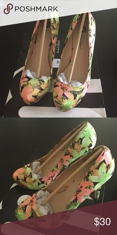 Brand new floral pumps Brand new floral pumps by Michael Antonio. 3 1/2 inches with 1/2 platform. Style name is love me flower. Color is coral flower. Never worn and in original packaging. Michael Antonio Shoes Heels