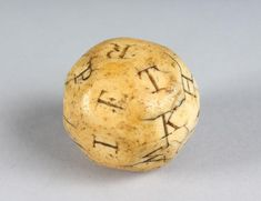 A RARE CARVED SCRIMSHAW IVORY ALPHABET GAME DICE with capita