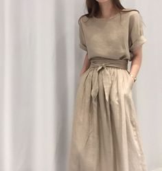 Beige belted summer dress with full skirt and high neck