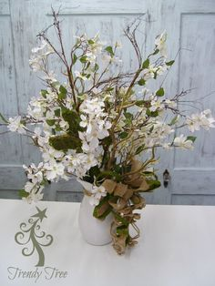 Spring arrangement using RAZ Dogwood Spray, Twig Branches, Moss Cross, Burlap Ribbon and Jute roping.
