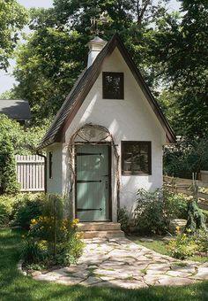 Aqua door garden studio; Andrea Rugg photo  Love the arbor over door & flag stone walk