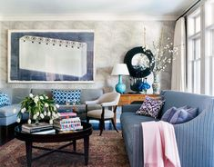 Soft purples and gray-blues in the living room of a Los Angeles house temper the deep indigo of a huge Los Carpinteros painting.