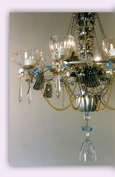 Candeliers by Madeleine Boulesteix....she makes the most incredible repurposed chandeliers....many of which end up at Anthropoligie. Take a peek...very cool! http://www.madeleineboulesteix.co.uk/