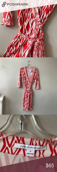 "Diane Von Fursetnberg Wrap Dress Red and white geometric/diamond pattern wrap dress with inverted trim (red with white and white with red diamonds).   Approximate dimensions when laid flat: Bust 18"" Sleeves 20"" Length 41""  RHC3740-4 Diane Von Furstenberg Dresses Midi"