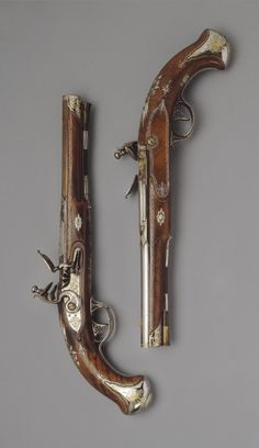 Pair of Flint-lock Pistols. Place of creation: Russia. Date: Circa 1800. School: Tula. Material: steel, gold, silver and wood. Technique: forged, carved, chased, engraved, damascened and polished.