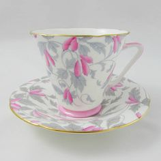 Teacup and saucer made by Royal Grafton. Both tea cup and saucer are covered in pink and grey flowers. Gold trimming on cup and saucer edges. Excellent condition (see photos). Markings read: Royal Grafton Bone China England Please bear in mind that these are vintage items and there
