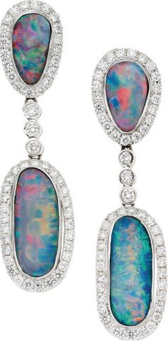 Opal, Diamond, White Gold Earrings -  The earrings feature pear and oval-shaped boulder opals weighing a total of 8.08 carats, enhanced by full-cut diamonds weighing a total of 4.06 carats, set in 18k white gold, completed by posts and omega backs. Gross weight 10.20 grams. Dimensions: 1-7/8 inches x 7/16 inches