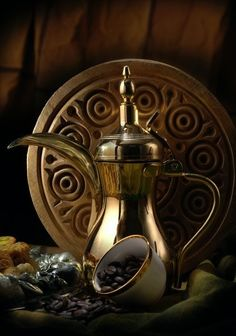 Arabic Coffee - it is so thick and strong that is served in tiny cups, one of which is seen in front of the pot
