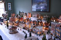 Nicely done! -Priscillas: Christmas foyer and dining room 2012 Christmas Tree Village, Christmas Town, Christmas Mantels, Christmas Minis, Christmas Villages, Christmas Holidays, Christmas Decorations, Holiday Decor, Christmas Displays