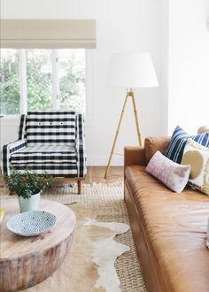 leather sofa + natural living room and cowhide rug // papernstitchblog.com