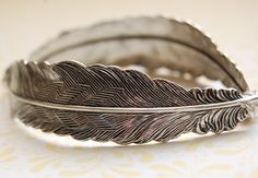 The Feather Bracelet - Sterling Silver. $48.00, via Etsy.