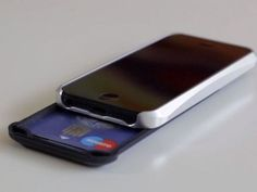 The iShove Wallet for iPhone 5 and 5S is able to carry 4 cards, 3 bills, 2 keys and it's even got a credit card stand!