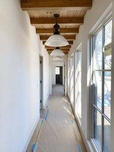A progress update on Amber Lewis' own home with her favorite brands including Waterworks, Marvin, Duchateau, Portola Paints, the Container Store and more. French Country Exterior, Bathtub Walls, Wood Garage Doors, Fireclay Tile, White Oak Floors, Colored Ceiling, Amber Interiors, Eclectic Design, Entry Hall