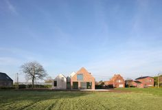 Belgian studio Atelier Tom Vanhee upgraded a former brick farmhouse into a contemporary low-energy home. Mini Clubman, Zinc Roof, New Staircase, Old Bricks, House Roof, Farm House, Residential Architecture, Modern Farmhouse, Farmhouse Ideas