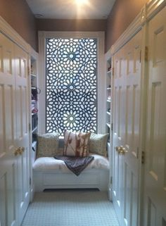 Lacy screens have been used for centuries in hot desert climates to create cool, sun-dappled interiors. The same approach is used to great effect in this dressing room and closet. The Delia solar shade filters the light and provides privacy.