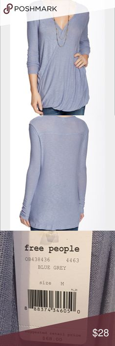 Free People Blouse The fabric is super soft!  The color is blue/grey. It has a surplice neck and long sleeves with snap button closure. It's draped with a slight bubble hem. Great on with jeans or leggings! Free People Tops Blouses