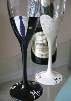 Bride and Groom toasting flutes, Hand Painted customized. $30.00, via Etsy.