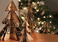 DIY Mini Christmas Tree Paper Ornaments-these are very cute! It will be my first Christmas project of the season. I even have some vintage Christmas music to use! I will probably ink and glitter the edges as well. Diy Paper Christmas Tree, Paper Christmas Decorations, Tabletop Christmas Tree, Paper Ornaments, Christmas Tree Ornaments, Christmas Fun, Xmas Trees, Origami Ornaments, Modern Christmas