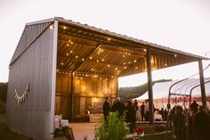 Country Australian wedding venue. Old rustic hayshed converted into reception venue. String lighting adds to the effect and ambiance. Authentic Australian Wedding location, near Sydney, NSW. http://www.chapmanvalleyhorseriding.com/country-australian-wedding-part-1/ Bride and Groom. Wedding Ceremony. Wedding Ideas. Rustic wedding. Outdoor wedding. Native flowers. Country wedding venue. Australian wedding venue. Timber. Wedding Ideas.