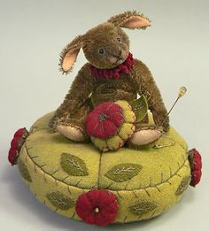 bunny pin cushion... such sweet felt! and fun to use a little stuffed toy this way.