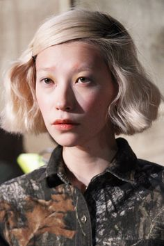 Blond bob & translucent brows.