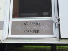 Camper screen door makeover. A little spray paint and a vinyl sticker.