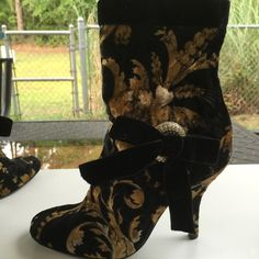 STUNNING Casadei ankle boots FINAL REDUCTION Gorgeous mint condition. made in Italy Worn once no flaws no rips dings no stains they are leather and velvet on a side  each boot have a disc covered in Swarovski crystals  GORGEOUS and impossible to find size 5.5 but they will fit a size 6  I HAVE ANOTHER LISTING W ADDITIONAL PICTURES .... Casadei Shoes