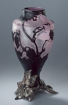 Vase by Emile Galle for Faberge, 1896. Decorated with flowering shoots of clematis with a mount by Yury Rappoport, St Petersburg. Three-layered glass, mould-blown and engraved. Silver mount is cast, chased and engraved. H: 19.8 cm, D: 9.7 cm | Hermitage Museum