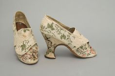 Woman's Shoes, c. 1770. In the eighteenth century shoes were usually symmetrical, and often made of beautiful but fragile silks, such as this floral brocade. This pair shows features fashionable in the mid-eighteenth century, including high, thick heels and front lappets, which were usually fastened with a buckle.