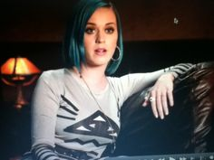 Katy Perry wearing a shirt with the eye of Horus which is on US currency.
