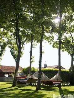 Hammocks from L.L. Bean. Photo: Francesco Lagnese. housebeautiful.com. #hammocks #stripes #outdoor_space #backyard