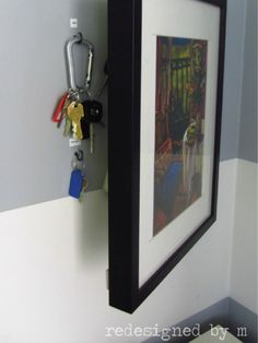 When hung on a hinge, wall art can keep keys safe (and stop them from cluttering up your entryway).