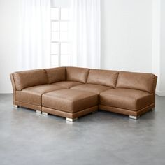 Shop gybson brown leather sectional sofa. Designed by Mermelada Estudio, loveseat offers up laid-back '70s vibe with minimalist lines and maximum comfort.