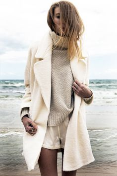 Winter white outfit with a turtleneck sweater and short shorts.