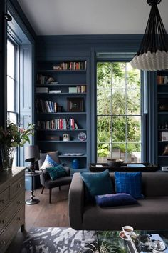 I like this color pallete... the navy/grey walls with the white ceiling, it lets the blue pillow pop and have it's own life.