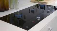 Fisher and Paykel Gas in glass cooktop- brilliant!!!! Individual gas burners that retract flush into the glass surface when not in use. Now I can have both worlds gas cook surface and glass for easy clean up!!!!