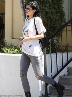 Holey moley: Kylie Jenner steps out in ripped skinny jeans and torn T-shirt as she grabs lunch with male friend .