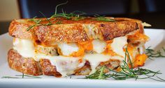 Take a trip to Korea without leaving your kitchen. This sweet and spicy sandwich features layers of Wisconsin cheese curds, spicy kimchi, sweet Italian sausage and nutty Swiss piled on multigrain bread.