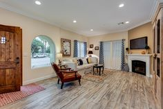 A rustic door, arched window and distinctive flooring add timeless style to the 1594 Plan, a new townhome built by Florence Homes in Downey, CA.